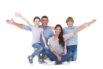 Happy family with arms outstretched over white background