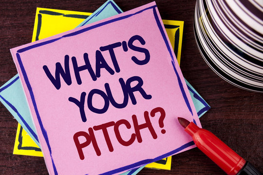 Word writing text What Is Your Pitch Question. Business concept for Present proposal Introducing Project or Product written on Pink Sticky Note paper on wooden background Cup and Marker next to it