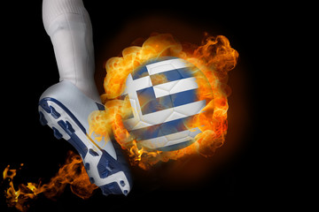 Football player kicking flaming greece flag ball against black