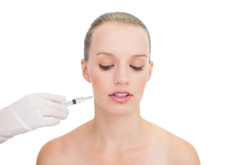 Stressed pretty blonde model receiving botox injection