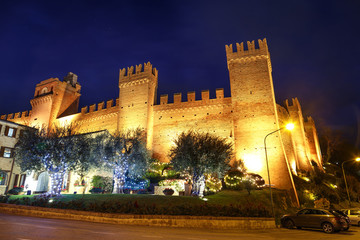Night view of the beautiful medieval Gradara castle near Pesaro city during the Christmas holidays, Marche, Italy.