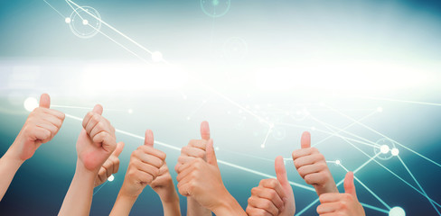 Group of hands giving thumbs up against circles on glowing background