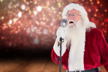 Santa sings like a Superstar against shimmering light design over boards