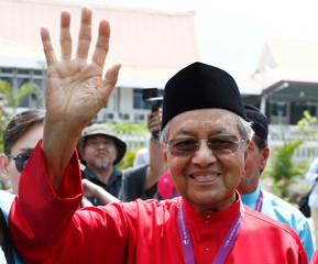 Former Malaysian Prime Minister Mahathir Mohamad waves to his supporters after his nomination, on Langkawi island