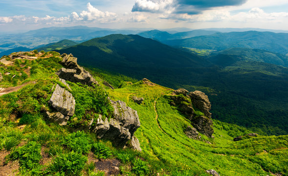 rocky cliff over the valley. beautiful mountain landscape in summer