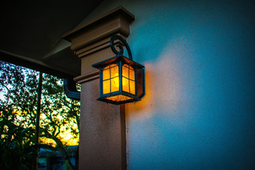 Light on house at sunset glowing orange