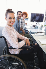 Portrait of smiling businesswoman sitting on wheelchair