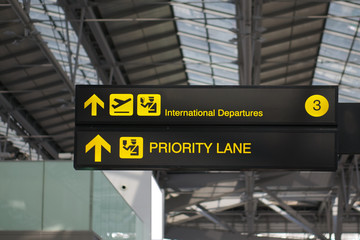 Departure and priority lane board sign at international airport