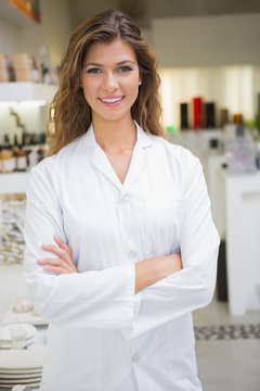Portrait of smiling beautician with arms crossed