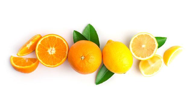 fresh orange and lemon on white in top view