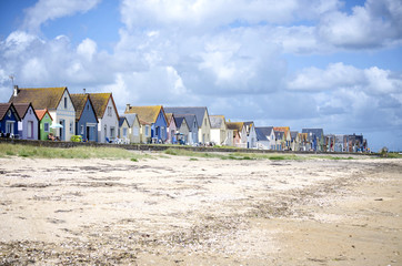 Normandy, Gran Hameau des Dunes. Row of colorful houses on the beach. Cotentin. Normandy. France.
