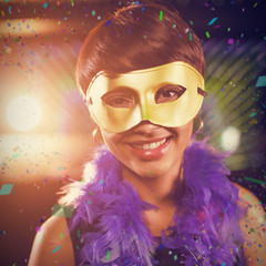 Woman wearing masquerade in bar against flying colours