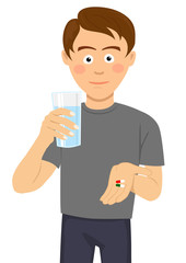 Young man is ready to take pills holding a glass of water