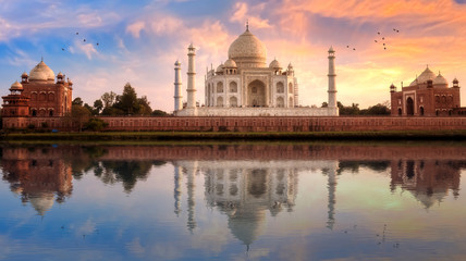 Wall Mural - Taj Mahal Agra with view of east and west gate at sunset with water reflection.