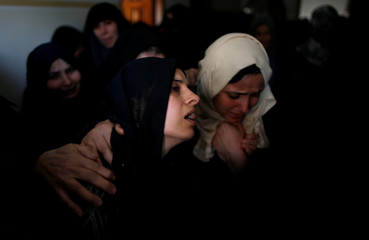 Palestinian mother of  Azam Ewidah,15, who was killed at the Israel-Gaza border, mourns during his funeral in the southern Gaza Strip