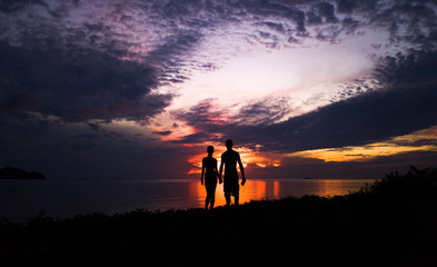 Couple in love silhouette during sea sunset