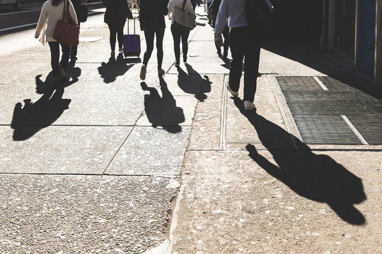 Shadows of people walking in New York on 5th avenue