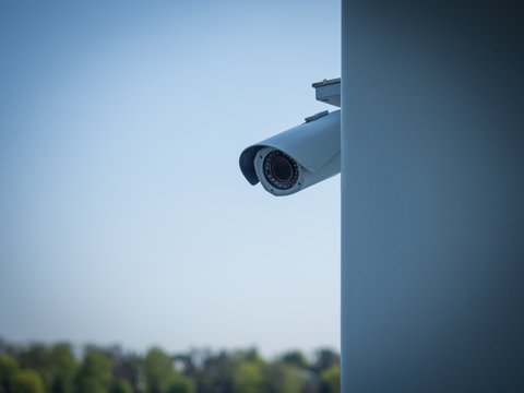 Security camera behind wall - concept of privacy invasion issue