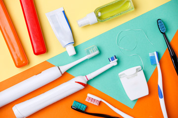Photo of toothbrushes, tubes of pastes, floss
