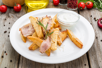 Young fried potatoes with bacon and onions