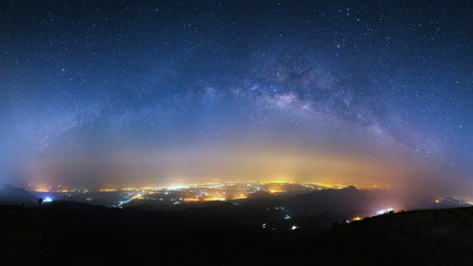 milky way galaxy and city light at Phutabberk Phetchabun in Thailand.Lo