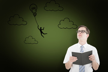 Geeky businessman reading from book against green background with vignette