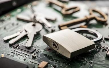 Padlock on computer circuit board.Security concept