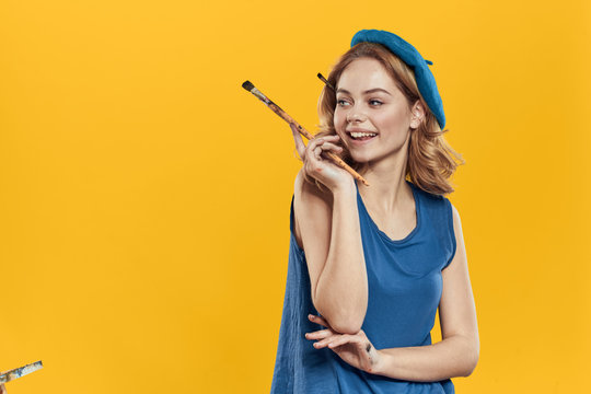 artist with a brush on a yellow background