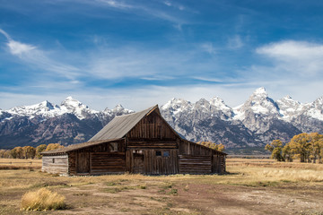 A barn on Mormon Row in Grand Teton National Park. In the background are the beautiful mountains of Wyoming, USA.