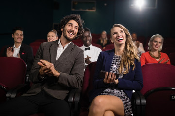 Couple watching movie in theatre