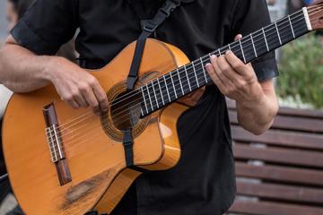 MAN PLAYING CLASSICAL GUITAR FISHERMANS WARF SAN FRANSISCO