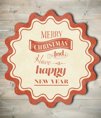 Banner and logo saying merry christmas against bleached wooden planks background