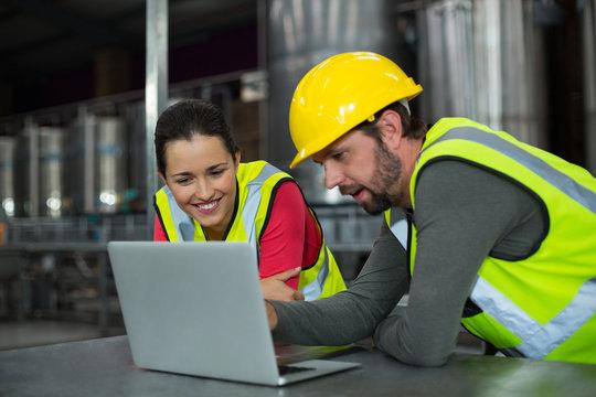 Factory workers using digital tablet