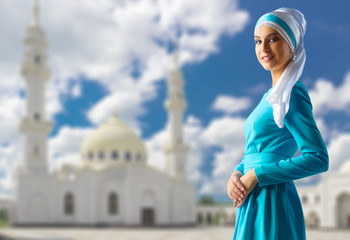Muslim woman on white mosque background