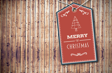 Merry Christmas banner against wooden planks background