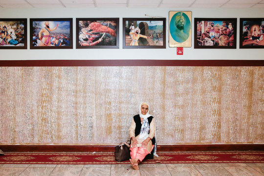 A follower of Sikhism makes eye contact with the camera sitting at the Sikh Cultural Society in Queens