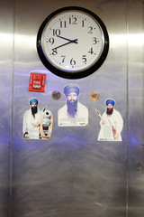 Images of Jarnail Singh Bhindranwale are seen under a clock at the Sikh Cultural Society in Queens, New York