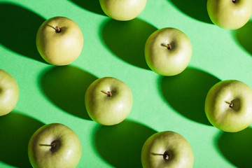 Apples on green background