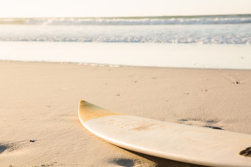 Surfboard on shore at beach