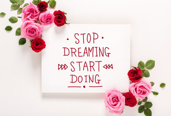 Stop Dreaming Start Doing message with roses and leaves top view flat lay
