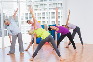 Women doing stretching exercise in gym