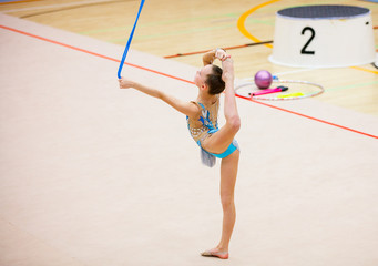 Foto auf Leinwand Gymnastik Adorable girl competing in rhythmic gymnastics
