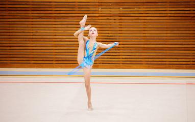 Printed kitchen splashbacks Gymnastics Adorable girl competing in rhythmic gymnastics