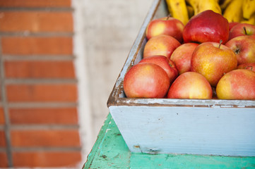 Closeup of fruit apples in box on street of Barbados