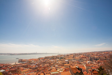 Old Lisbon Portugal panorama. cityscape with roofs. Tagus river. miraduro viewpoint. View from sao jorge castle