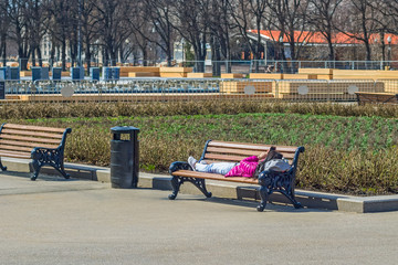 Girl lying on the bench