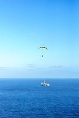 Far away Paraglider over oil rig in the atlantic ocean. Coast of Tenerife, Canary Islands.