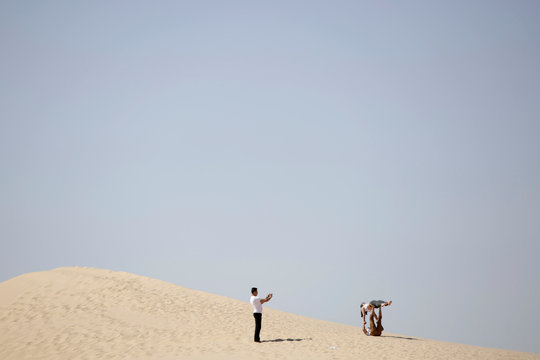 Yoga enthusiast pose for a picture after a class at the Samalayuca dunes