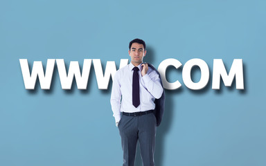 Unsmiling businessman standing against blue vignette