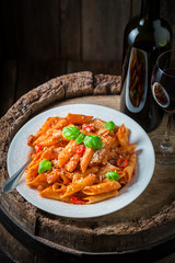 Enjoy your penne bolognese with parmesan and red wine